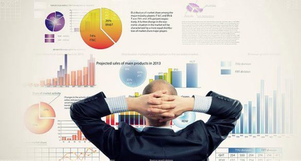 businessman looking at charts and graphs